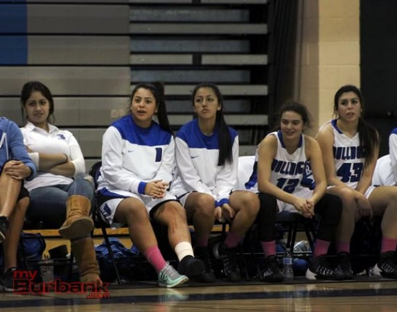 Ashley Linda, second from left, cheers from the bench at a recent game (Photo by Ross A. Benson)