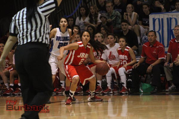 Delaney Nicol of Burroughs looks to drive out of traffic (Photo by Ross A. Benson)