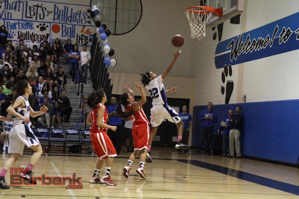Yazzy Sa'Dullah soars in for two of her game-high 18 points (Photo by Ross A. Benson)