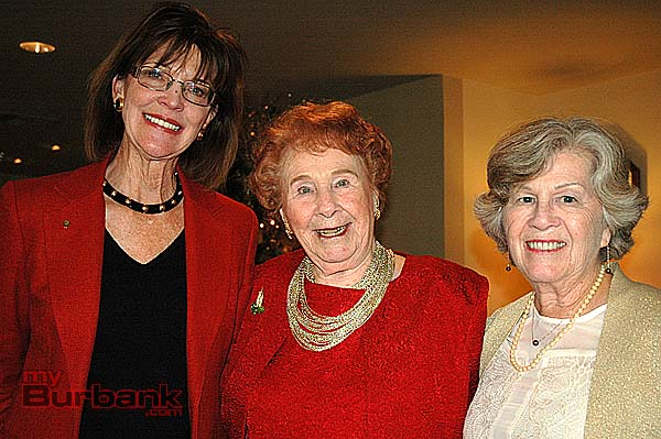Grace Mylroie Patz, center, celebrates her 100th birthday at the Providence St. Joseph Medical Center Guild Holiday Party with Burbank Mayor Emily Gabel Luddy, left, and guild President Patt Scully. (Photo by Joyce Rudolph)
