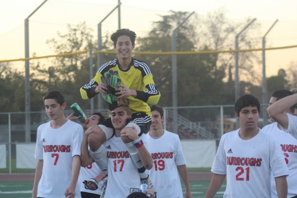 Burroughs goalkeeper Alberto Meir gets carried off the field after his goal tied Pasadena with seconds remaining (Photo courtesy of Mike Kodama)