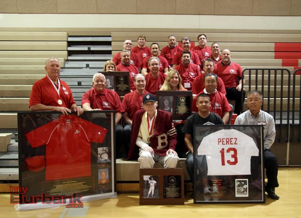 Mickey McNamee (center, wearing the Burroughs letterman sweater) was inducted into the Burroughs Hall of Fame this past October (Photo by Ross A. Benson)