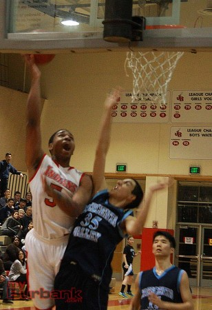 Amaad Wainright soars in for the layup (Photo by Dick Dornan)
