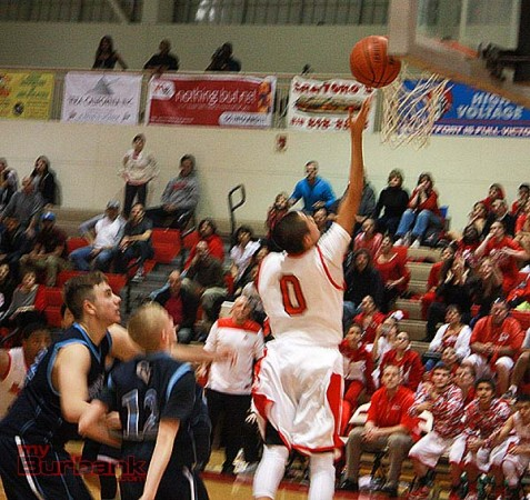 Steven Hubbell scores the game-winning layup with 14 seconds left to defeat CV (Photo by Dick Dornan)