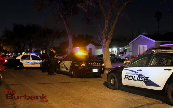 Burbank Police converge on the location where the victim was reported pickup from, to gather information from any witnesses and neighbors. ( Photo by Ross A. Benson)