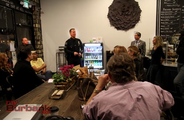 Burbank Police Sgt. Darin Ryburn talks with Magnolia Park shop owners as Councilmember Bob Frutos looks on. (Photo by Ross A. Benson)