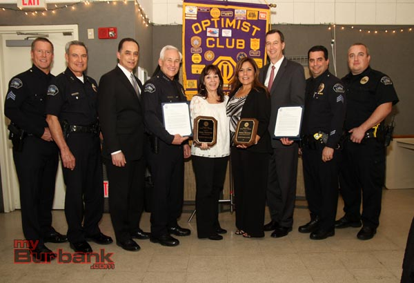 (from left to right) Sgt. Darun Ryburn, Deputy Chief Tom Angel, Captain Ron Caruso, Police Chief Scott LaChasse, Volunteer Awardee Linda Troncone, Civilian Awardee Norma Brolsma, Detective Ed Sander, Sgt. Claudio Losacco, and Officer Cameron Mencuri (Photo By Ross A. Benson)