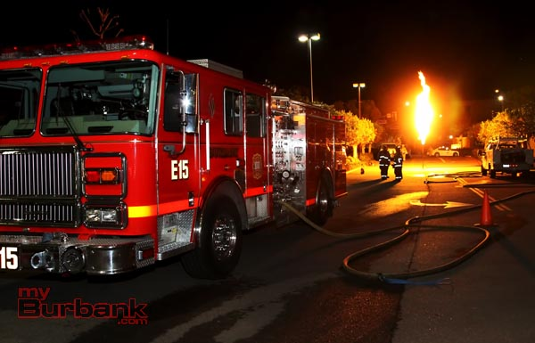 Burbank Engine 15 and 3 Fire Fighters stand by as propane is burned off. ( Photo by Ross A. Benson)