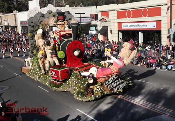 "Burbank's award winning float "" Light Camera Action"" with Director Gary Marshall sitting in his Directors Chair as his son Scott operates the camera on the opposite side. (Photo by Ross A. Benson)"