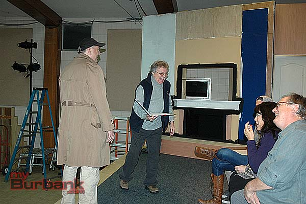 "Daniel Roebuck, left, listens as George Strattan shares a light moment with the Saint Francis Stage Company cast rehearsing ""God's Favorite"" opening its two-weekend run on Friday. (Photo by Joyce Rudolph)"