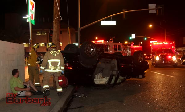 Burbank Fire Paramedics check out the driver of this overturned Infinity after it was involved in a auto accident Burbank Blvd. & Burbank Blvd.