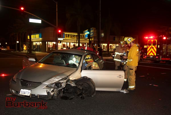 Burbank Fire Paramedics treat the driver of this auto after it was involved in an accident at Burbank Blvd. and Buena Vista Friday evening. (Photo by Ross A. Benson)