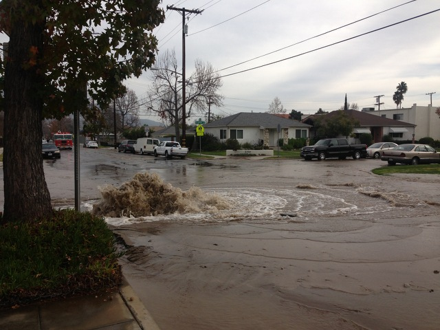 Water continues to flow from a broken water main at Brighton and Winona )Photo Courtesy of Burbank Police Dept.)