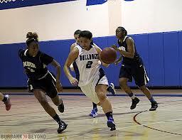 Ashley Linda dribbles up court against Muir last season (Photo by Ross A. Benson)