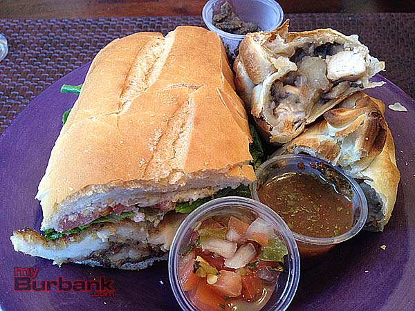 Chicken Milanesa sandwich and a Chicken Marsala empanada special are brightened with some fresh pico de gallo and chimmichurri. (Photo By Lisa Paredes)