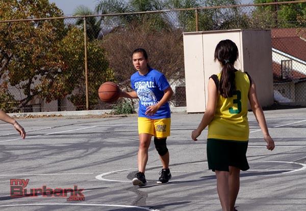 Jordan player dribbles up court (Photo by Ross A. Benson)
