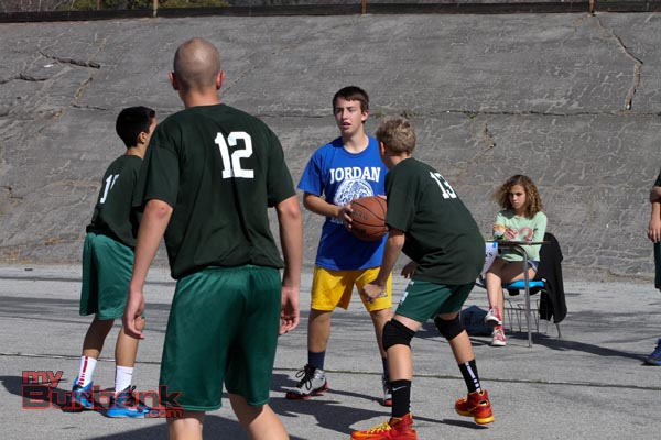 Muir surrounds a helpless Jordan player (Photo by Ross A. Benson)