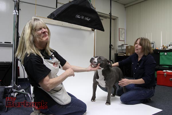 Lorry Izor reacts after getting kissed by Maytag a Pit Bull Terrier Deb Cobb looks on. ( Photo by Ross A. Benson)