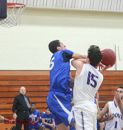 Anthony Kardosh challenges the shot of a Hoover player (Photo by Dick Dornan)