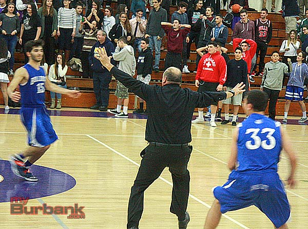 Burbank coach Jerry DeLaurie rushes the floor after his team pulled out the win (Photo by Dick Dornan)