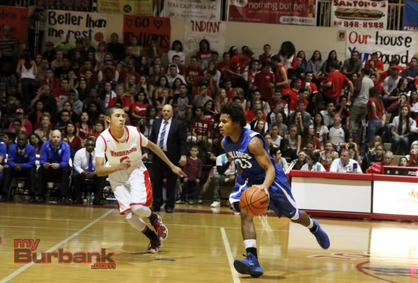 Cody Boseman drives up court for the Bulldogs (Photo by Ross A. Benson)