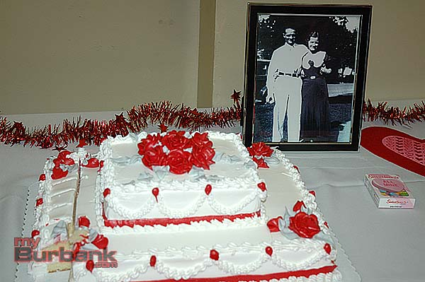 An early photo of Edna and Harold Owings was displayed next to a celebratory cake. (Photo By Joyce Rudolph)