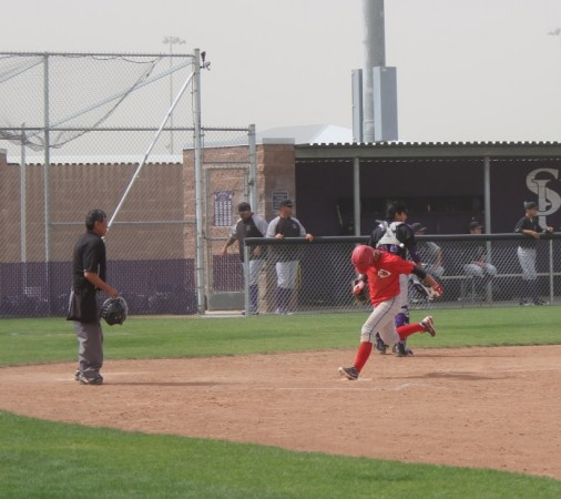 Anthony Pelayo scores the winning run in the bottom of the 8th inning (Photo courtesy of Ivan Galan)