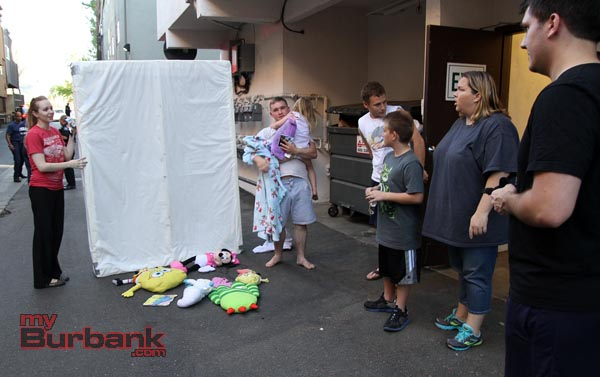 After Paramedics took the 3 year old to the hospital to be checked out, the mattress that was under the window, was moved and some of the stuffed animals the child was seen throwing out the window prior to falling out was under the mattress. ( Photo by Ross A. Benson)