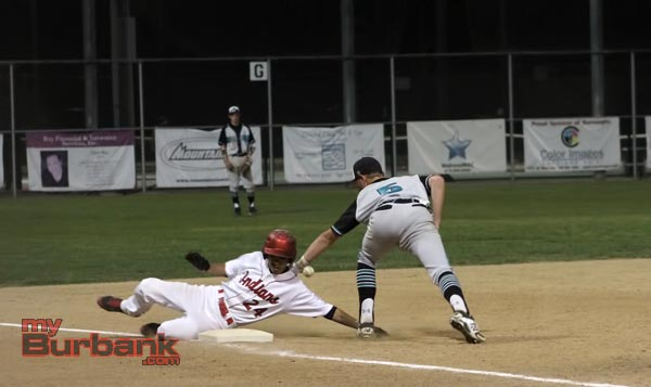 Burroughs' Ronny Jimenez slides in safely at third base (Photo by Ross A. Benson)