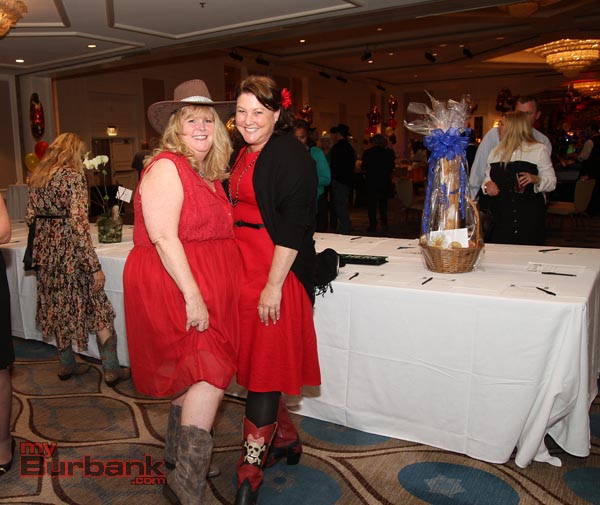 Comparing dresses and boots at this years Chamber Gala called Boots & Bling is Karen Volpei & Peggy Flynn.(Photo by Ross A. Benson)