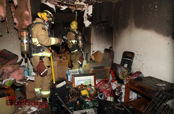Damage from smoke was extensive throughout the small controverted apartments. ( Photo by Ross A. Benson )