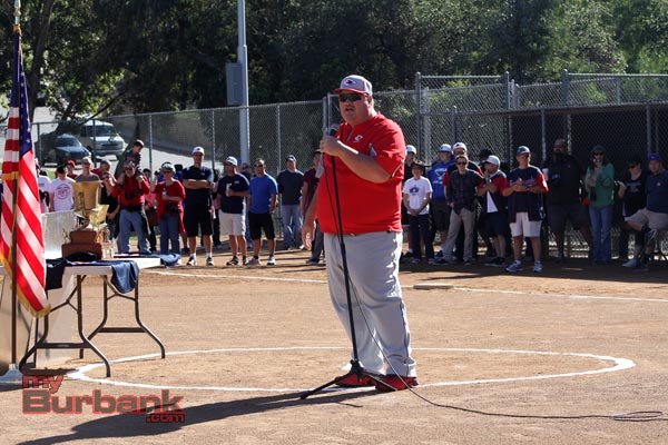 """Burroughs High School baseball coach Craig Sherwood was the guest speaker of the day. After a few words of """"The Grass is Green; The Sky is Blue"""" it's time to play baseball the festivities moved on (Photo by Ross A. Benson)"""