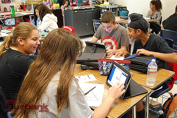 Students work in project groups using the iPads. (Photo By Lisa Paredes)