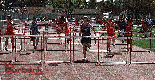 Corwin Scherer of Burroughs (middle lane) won the 110 hurdles as well as three other events (Photo by Dick Dornan)