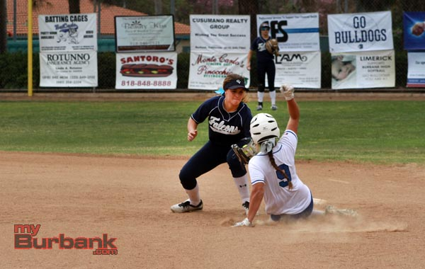Julia Duarte slides in safely at second base (Photo by Ross A. Benson)