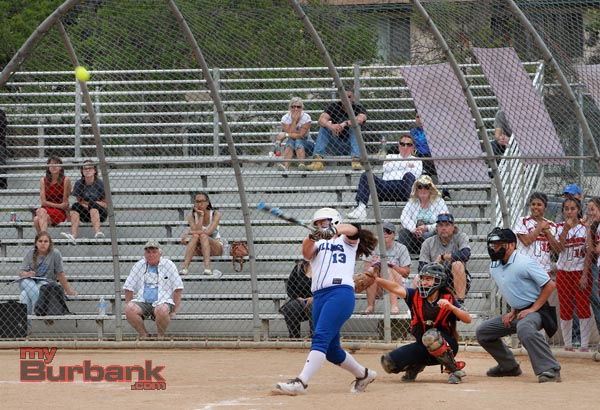 Caitlyn Brooks mashes an RBI double in the first inning (Photo by Ross A. Benson)