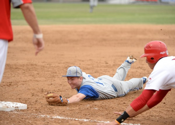 Fischer Cabot dives back to third base to apply the tag to double up an Indian runner (Photo courtesy of Mitch Haddad)