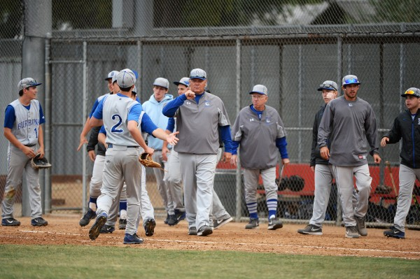 Burbank's Randy Higgens, #2, is congratulated by Coach Bob Hart after a fine performance (Photo courtesy of Mitch Haddad)