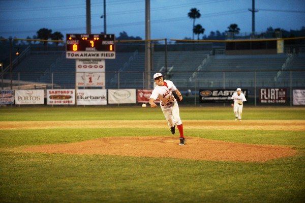Burroughs' Cole Meyer fires the last pitch to complete a 1-0 shutout against Burbank (Photo courtesy of Mitch Haddad)