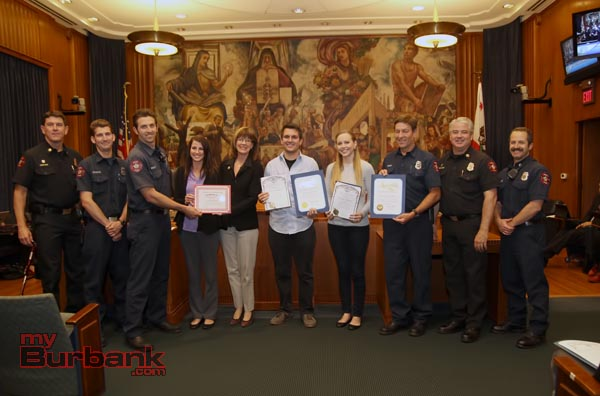 During Tuesday nights City Council Meeting Jennifer & Konrad Lightner were presented certificates from The Burbank Fire Dept, State Assembly and City of Burbank for their acts in saving a 3 year old after a fall from a 3rd story window. ( Photo by Ross A. Benson)