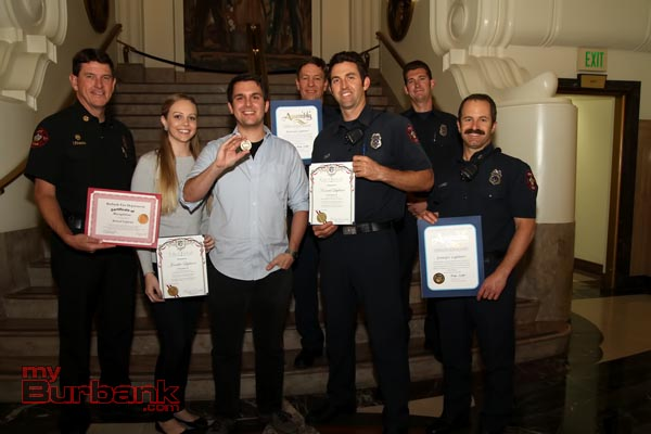 During Tuesday nights City Council Meeting Jennifer and Konrad Lightner were presented certificates from the Burbank Fire Department, State Assembly and City of Burbank for their acts in saving a three-year-old after a fall from a third story window Pictured with the Lightners are Firefighters who responded to the incident. (Photo by Ross A. Benson)