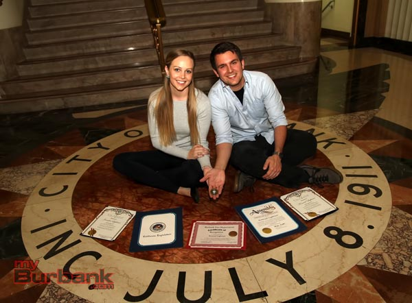 Jennifer & Konrad Lightner showing the awards and Challenge Coin they received during Tuesday night Jennifer and Konrad Lightner with certificates at the City Hall. (Photo by Ross A. Benson)