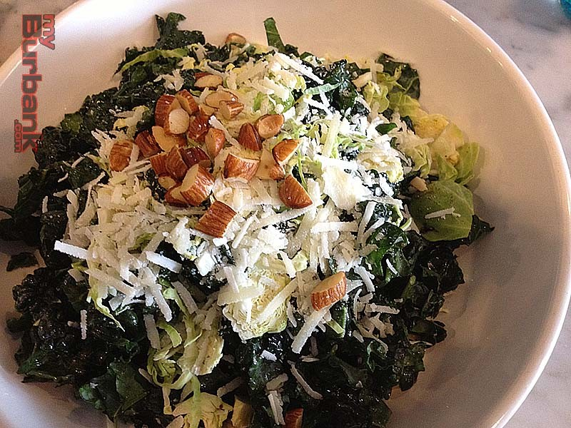 The kale and Brussels sprouts salad at Romancing the Bean is chock full of healthiness.  (Photo By Lisa Paredes)