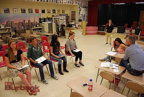 Students rehearse a scene while teacher Guy Myers and student producer Ella Essiambre (seated on the right) listen. Seated on the left are (from left to right) Tenley Patterson, Daniel Beimford, Samantha Rubin and Cassidy Boland, with Nick Apostolina in the back. (Photo By Lisa Paredes)