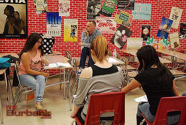 Student producer Ella Essiambre (left) checks some lines while director Guy Myers listens. Cassidy Boland and Samantha Rubin interact during a scene. (Photo By Lisa Paredes)
