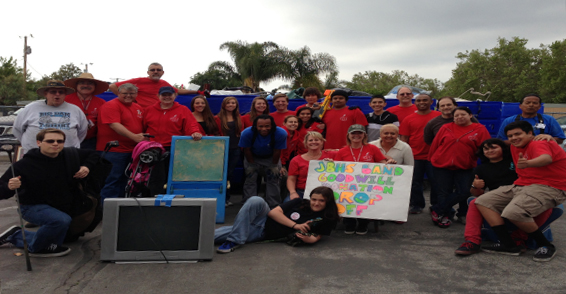 Members and supporters of Burroughs High School's Instrumental Music Association show some of the donations collected at the 2013 Goodwill Donation Drive. (Photo Courtesy John Burroughs High School Instrumental Music Association)