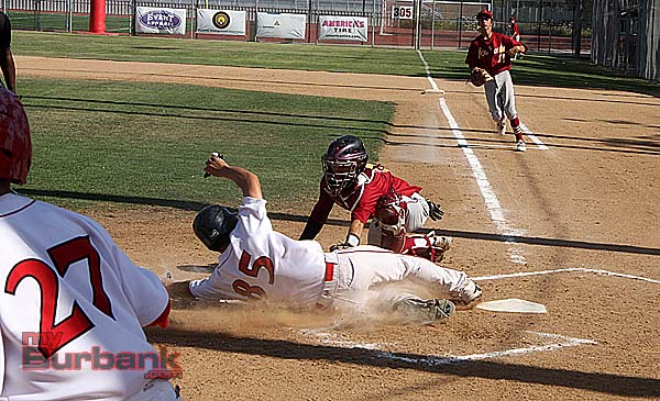 Burroughs' Roy Hirota slides in just before the tag for the game's only run (Photo by Dick Dornan)
