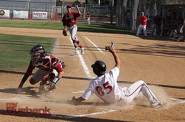 Roy Hirota safely slides by  for the Indians (Photo by Dick Dornan)