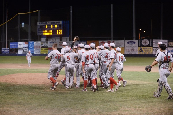 Burroughs celebrates the victory and playoff clinching berth (Photo courtesy of Mitch Haddad)