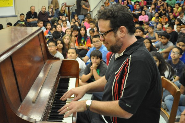"Christophe Beck performs a theme from ""Frozen"" for Providencia Elementary children. (Photo Courtesy of Education Through Music - LA)"